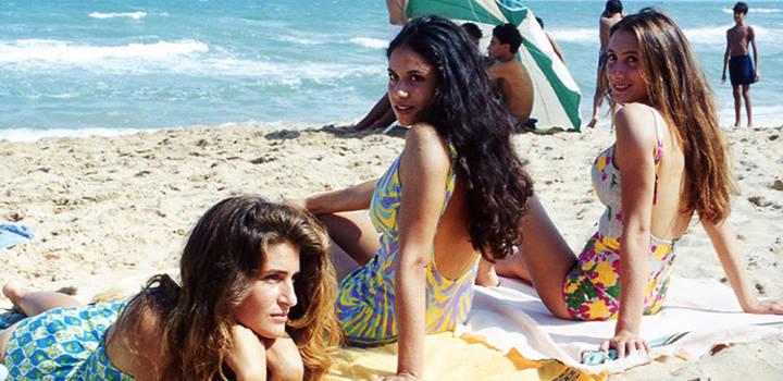 Gigi, Merriem and Tina lie on the beach at La Goulette